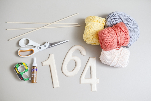 SomethingTurquoise_DIY-yarn-wrapped-table-numbers_0002.jpg