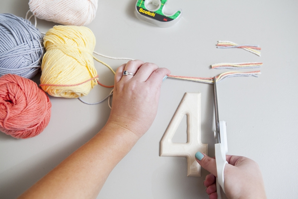 SomethingTurquoise_DIY-yarn-wrapped-table-numbers_0003.jpg
