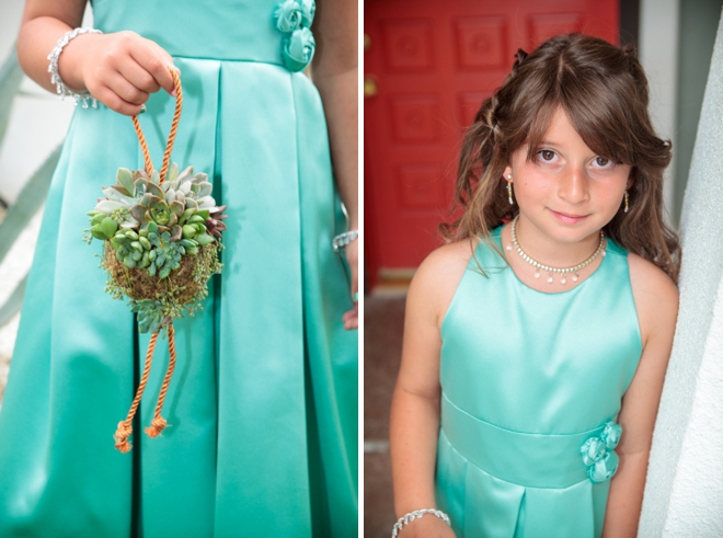 Turquoise flower girl with succulents