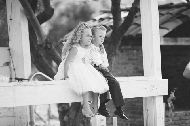 Ring bearer and flower girl embrace