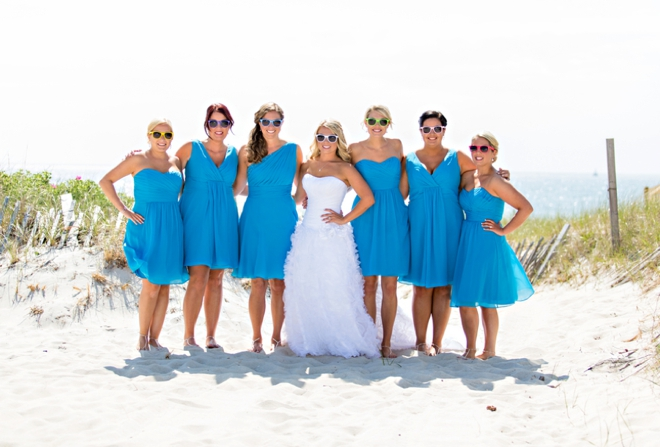 Darling bright blue bridesmaids with fun glasses!