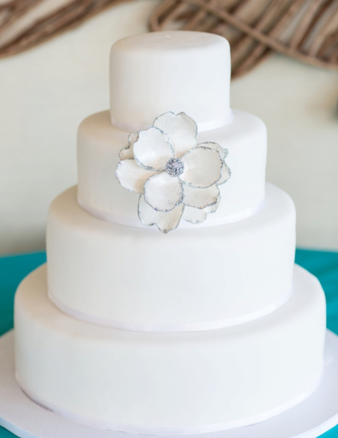 Beautiful simple white 4-tiered cake
