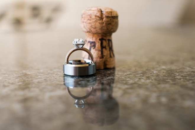 wedding ring shot with champagne cork