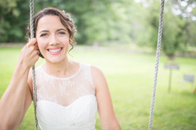 Bride sitting on a swing