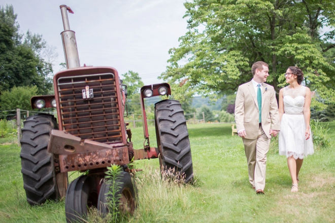 Bride and groom walking by tractor