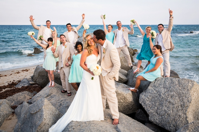 Beach wedding party on rocks
