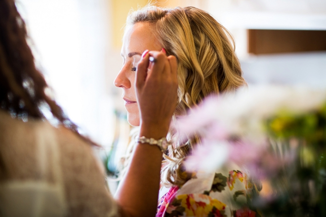 The bride getting makeup done
