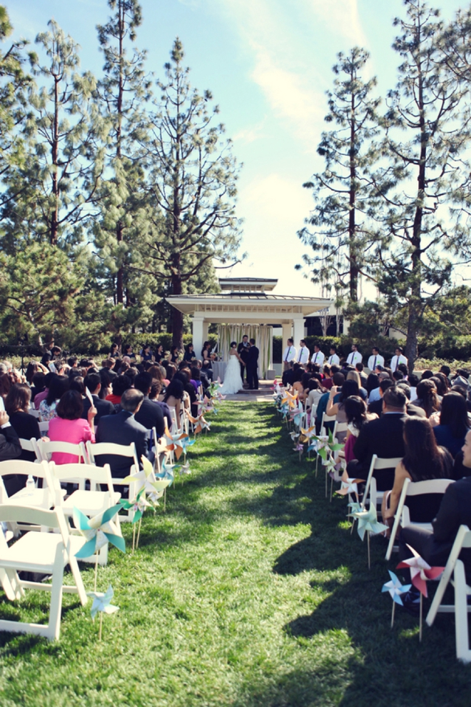 Ceremony with pinwheel decor down the aisle