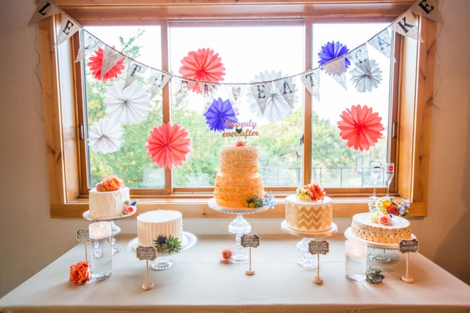 Colorful dessert table with multiple wedding cakes