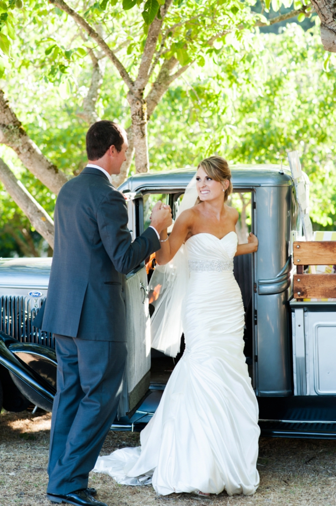 bride and groom traveling in vintage truck