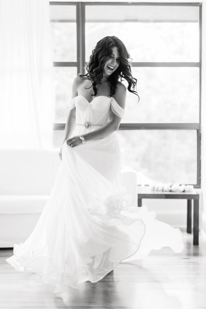 Bride twirling in beautiful dress.