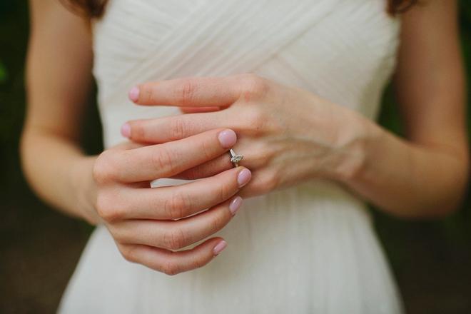 Wedding ring and pink nails