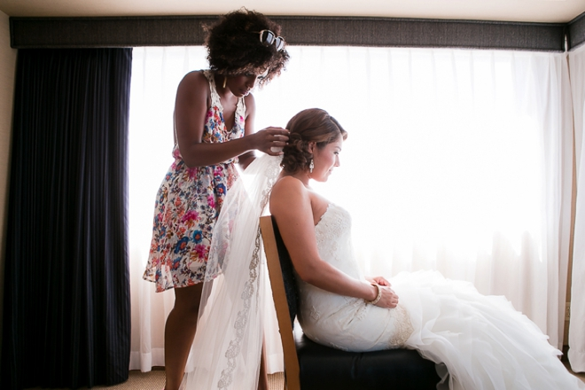 Putting on the brides veil