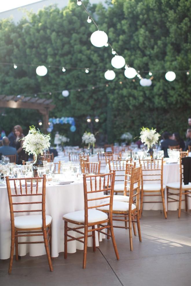 Outdoor wedding with hanging lanterns