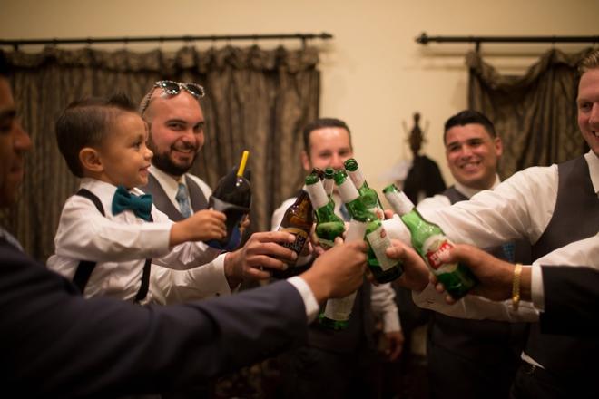 Groomsmen (and ring bearer) toasting!