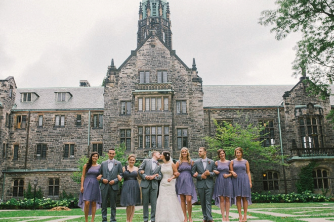 Gorgeous bride and groom portrait with bridal party