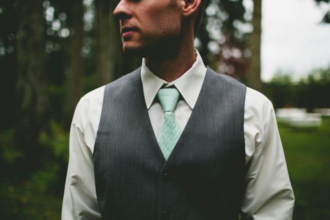 Gray suit, turquoise tie