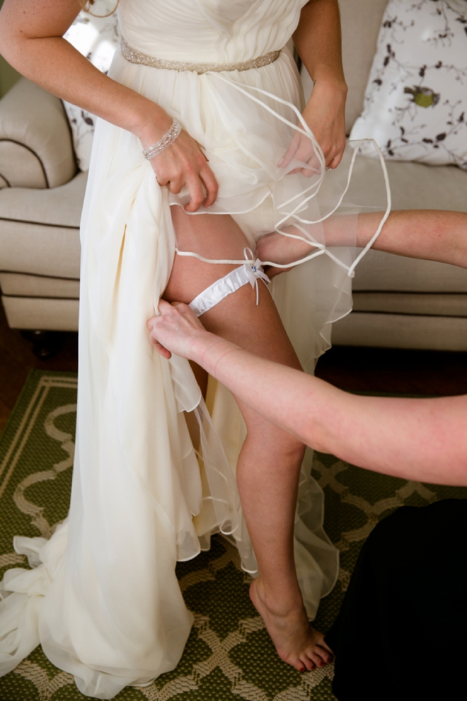 Putting on her garter