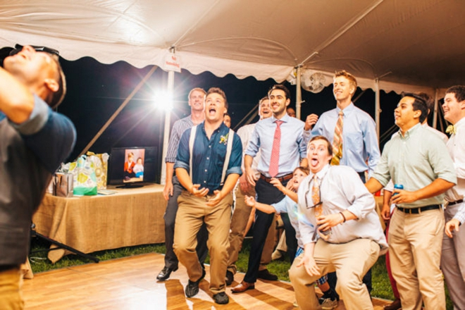 Groomsmen trying to catch the garter
