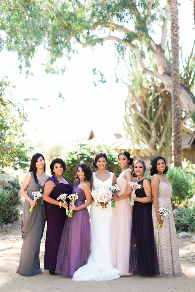 The bride and her purple bridesmaids