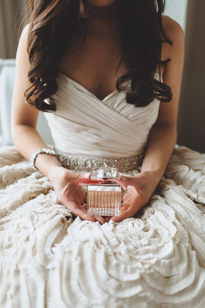 Bride holding her perfume.