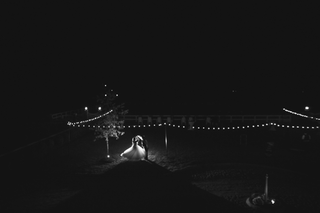 Bride and groom dancing at night, under the stars