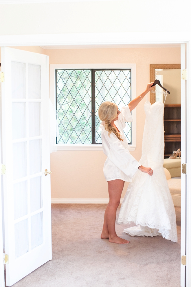 Bride holding her dress