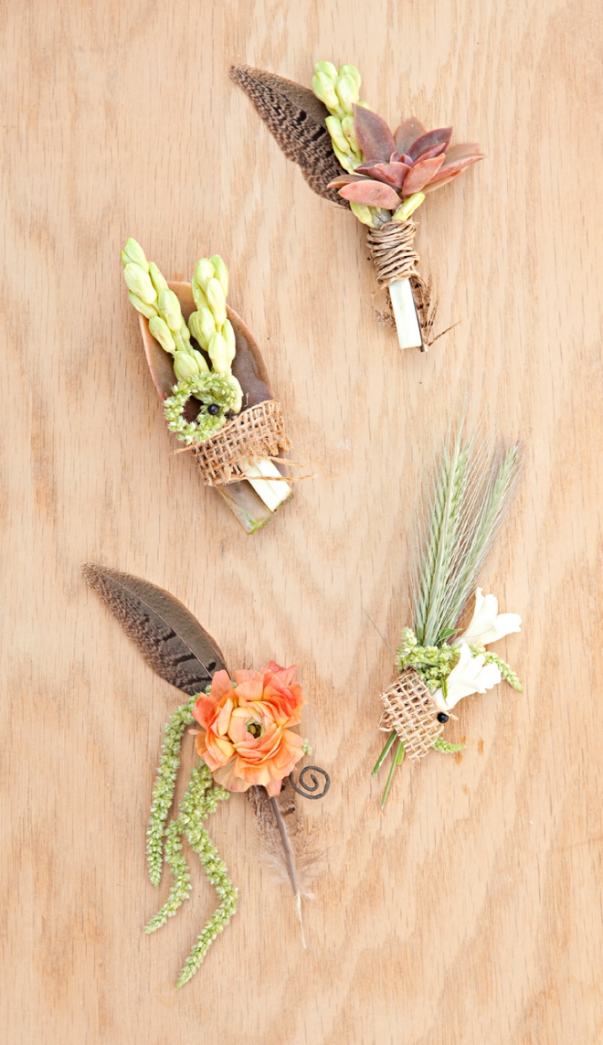 Boho-chic wedding boutonneires with feathers and succulents