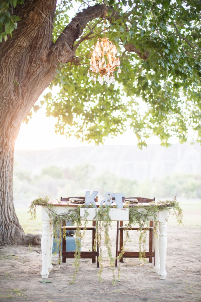 Vintage style sweetheart table with chandelier