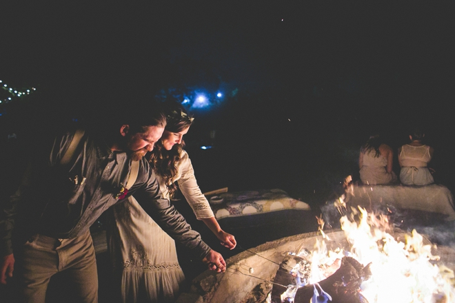 Bride and groom roasting s'mores