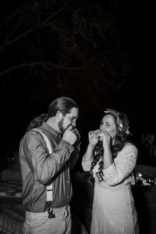 Bride and groom enjoying s'mores