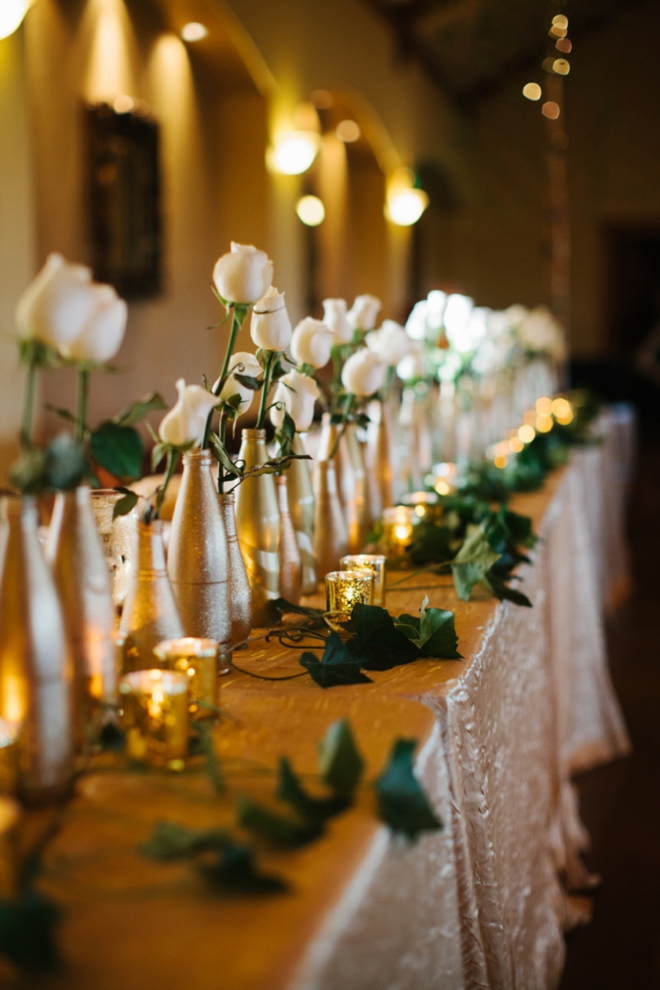 Gorgeous gold bottle and rose decor