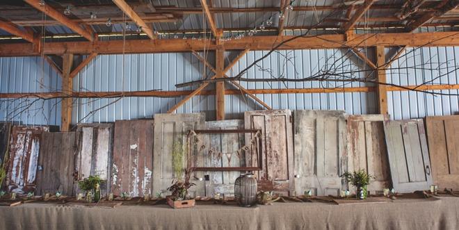 Old cabin doors as head table backdrop
