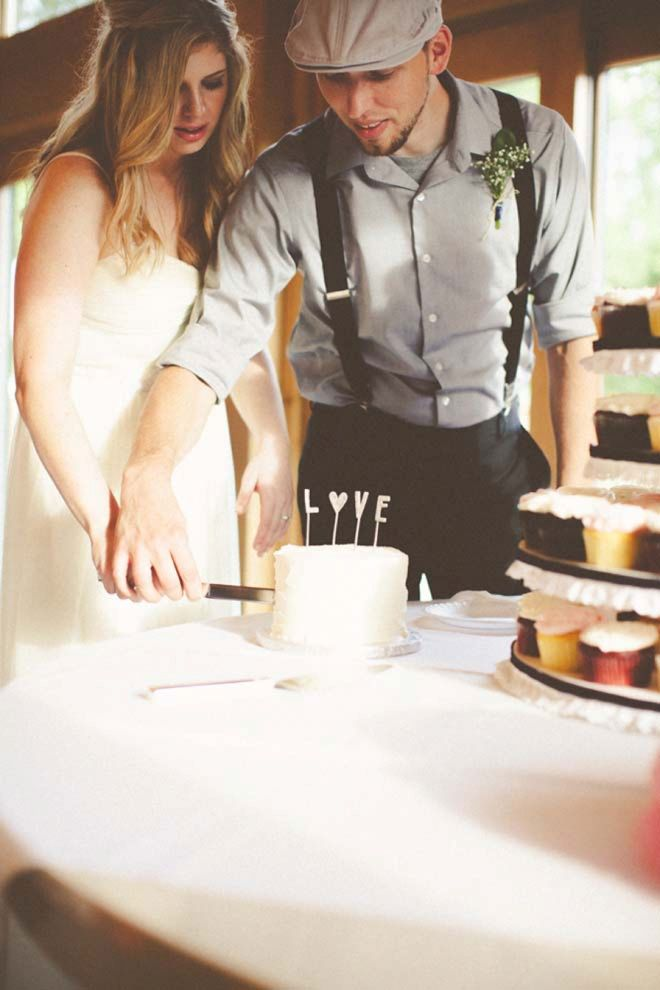 Couple cutting their mini-wedding cake