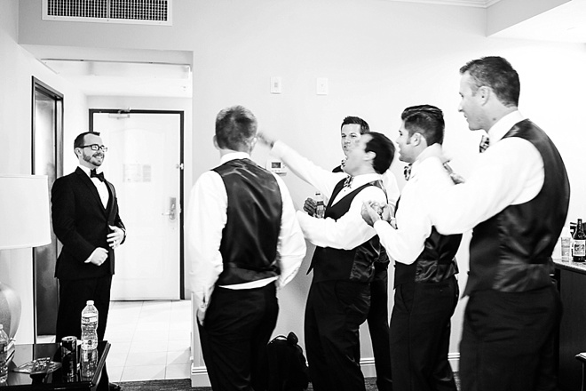 Groomsmen toasting the groom