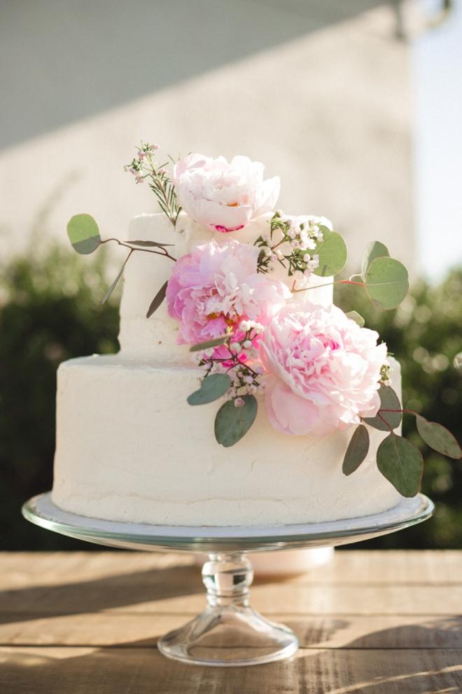 Peony and eucalyptus cake decoration