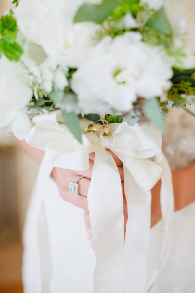 The bride carried her parents wedding rings with her down the aisle!