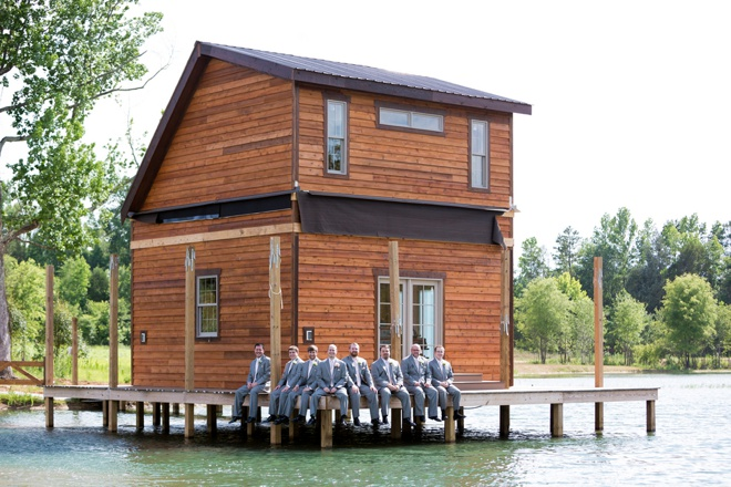 Groom and his men hanging out on a dock