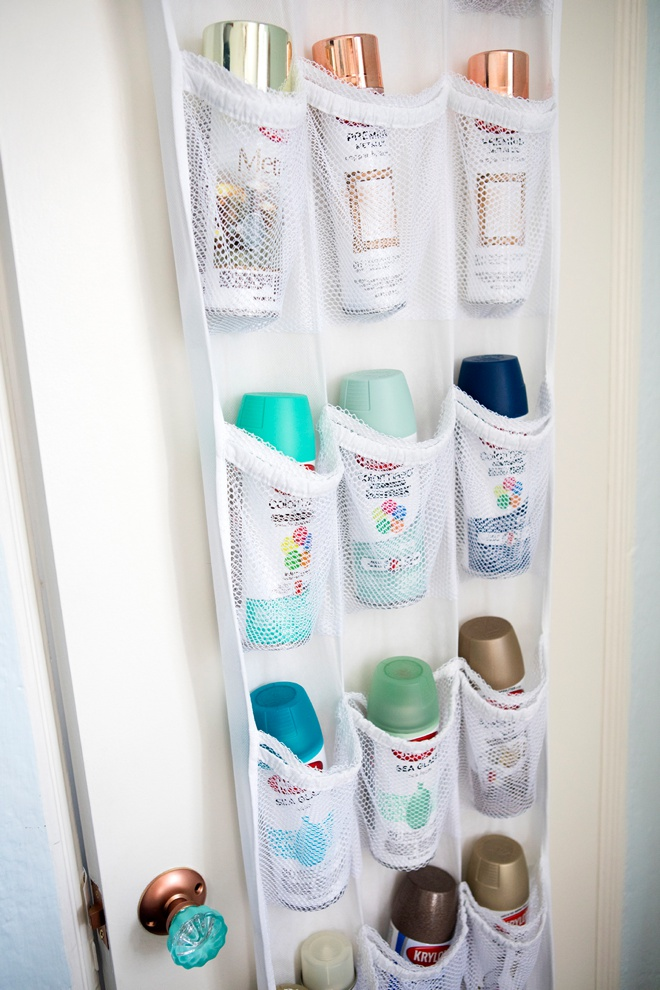 Use a back of the door shoe rack to hold spray paint!
