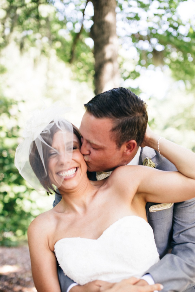 Awesome kiss + birdcage veil