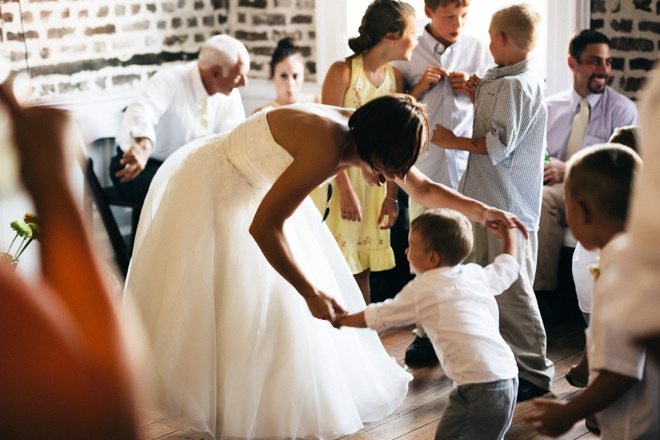 Bride dancing with ring bearer.