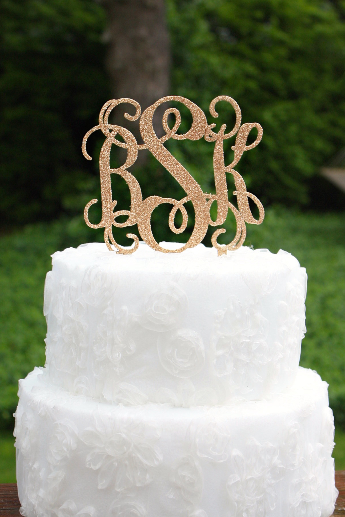 You could win a glitter monogram cake topper!