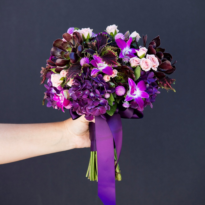 Stunning dark purple bridal bouquet with pops of pale pink mini-roses!