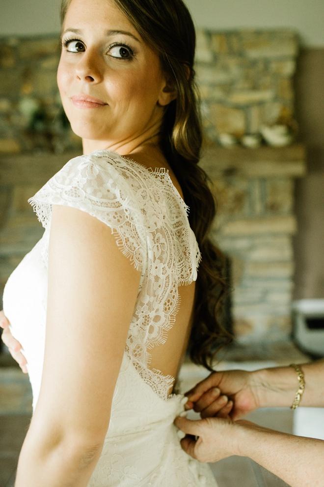 Stunning bride getting dressed