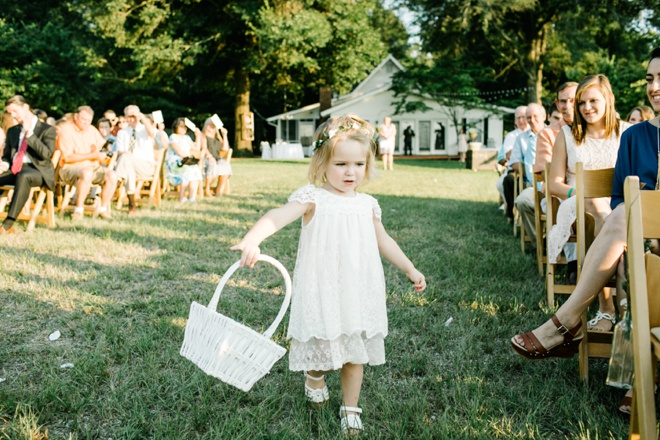 Darling flower girl making her way down the aisle