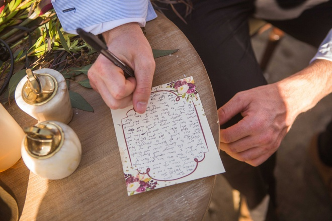 Groom writing a note to his bride