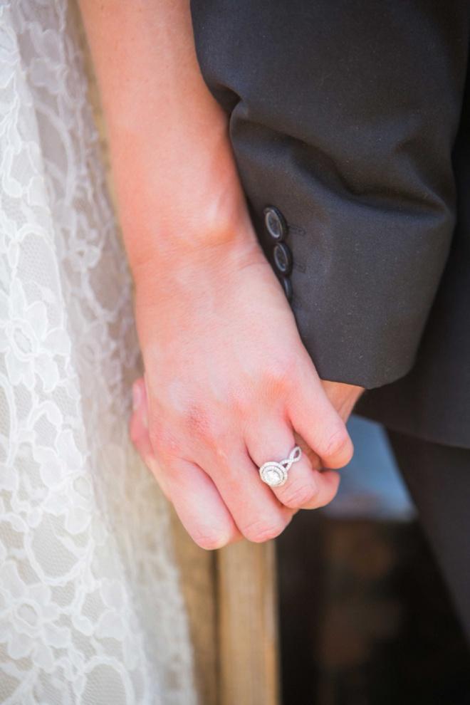Wedding ring shot holding hands.