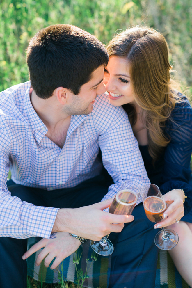 Darling engagement shot with couple toasting pink champagne!