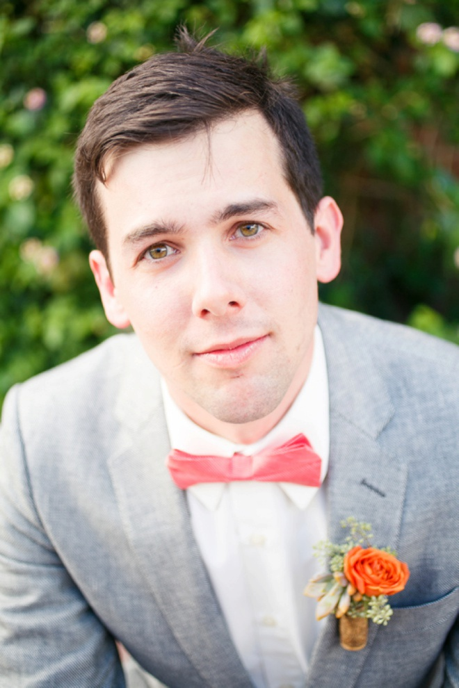 Groom in his sharp bow tie.