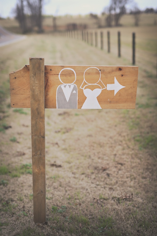 Painted bride and groom directional sign, so cute!